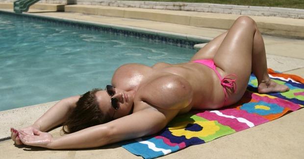 Hot babe Maria Moore sunning her titties
